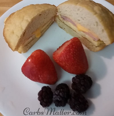 Scrambled egg, ham and cheese on low carb bun